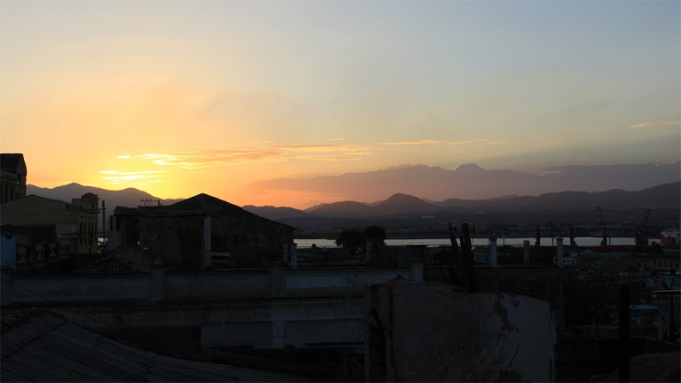 Sunset-over-the-Sierra-Maestro-as-seen-from-Roy's-Terrace-Inn,-Santiago-de-Cuba