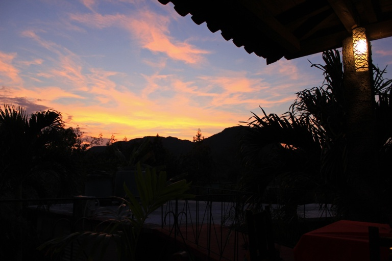 The-sun-setting-over-the-magotes-seen-from-Villa-Dary-y-Tuty,-Vinales,-Cuba